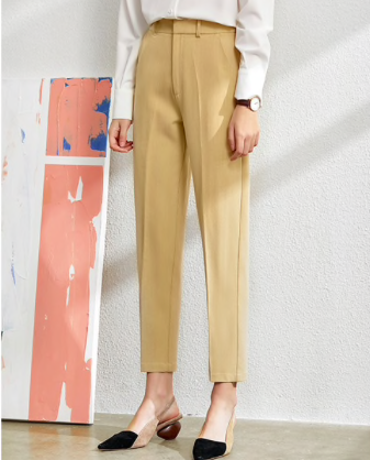 Suit for Women collection showing yellow pants worn by a model
