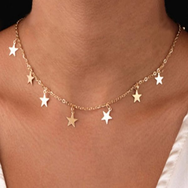 Star Gold Necklace worn by a model