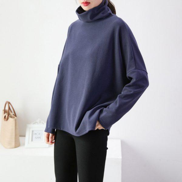 Turtleneck Batwing Sweater worn by a model