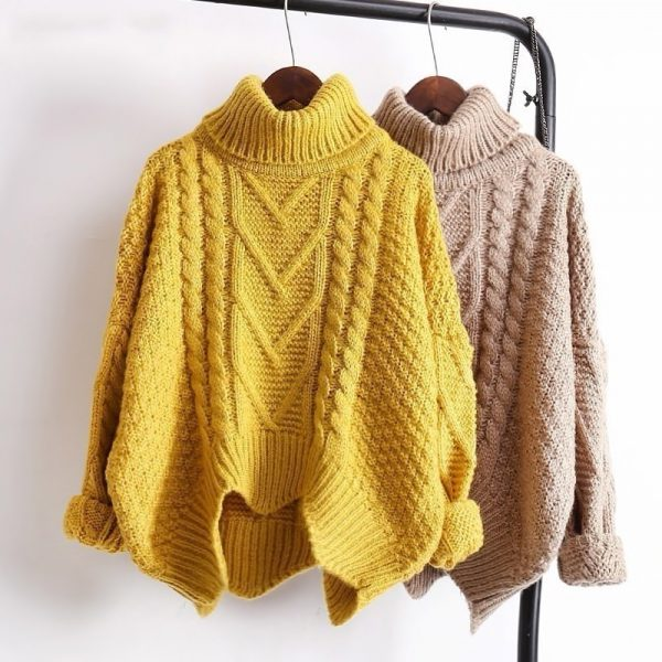 Turtleneck Knit Sweater hanging on clothes rack